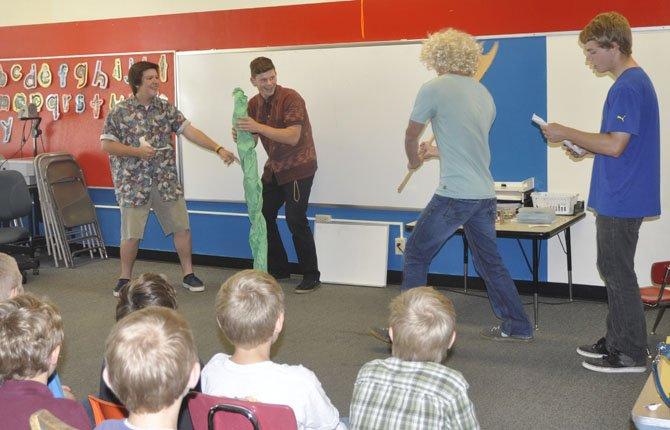 Students from Brian Greeley's Spanish classes at The Dalles Wahtonka High School practiced their Spanish last week by performing fairy tales for elementary school students at Colonel Wright Elementary. From left to right are Zach Keimig, Clayton Copper, Adam Holeman and Nick Glesner portraying Jack and the Beanstalk. Other fairytale retellings in Spanish included The Boy Who Cried Wolf, Little Red Riding Hood, The Three Little Pigs and Hansel and Gretel.