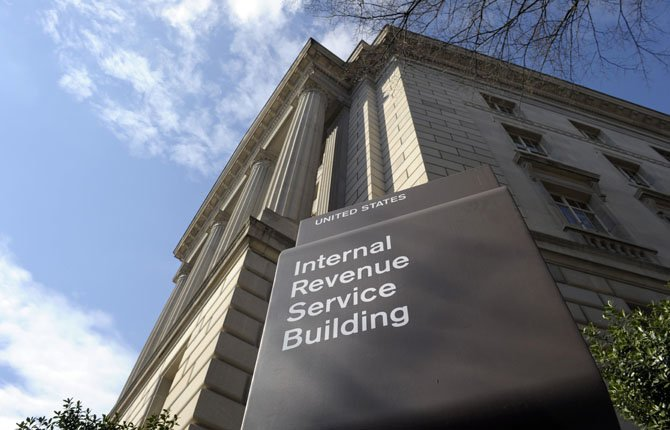 THIS MARCH 22 file photo shows the exterior of the Internal Revenue Service building in Washington. Experts say the Internal Revenue Service's improper treatment of conservative groups seeking tax-exempt status stems partly from its having to enforce conflicting laws vaguely describing the activities that such organizations may conduct.
