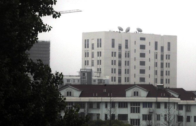 "PHOTO TAKEN May 31 shows the building housing ""Unit 61398"" of the People's Liberation Army, center top, in the outskirts of Shanghai, China. After years of quiet and largely unsuccessful diplomacy, the U.S. has brought its persistent computer-hacking problems with China into the open, accusing Beijing's government and military of computer-based attacks against America. Officials say the new strategy may be having some impact."