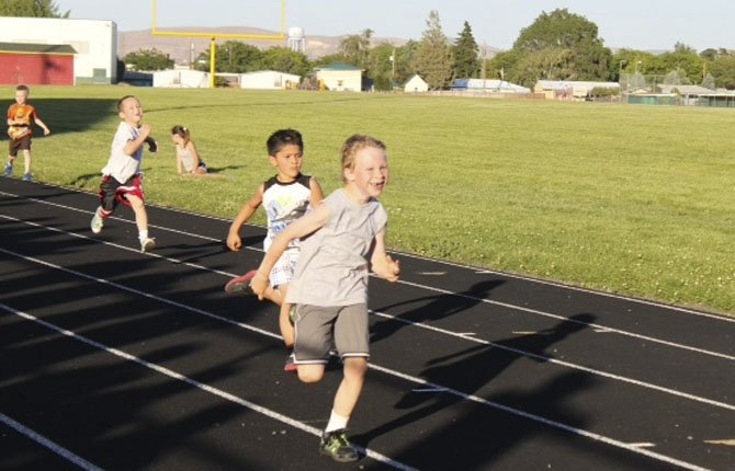 PARTICIPANTS from elementary schools across the gorge give it all they have in the 200-meter event held as part of the Jumpstart Track and Field Meet Tuesday at Sid White Field at Wahtonka High School in The Dalles. Close to 75 athletes from kindergarten-through-fifth grades were in attendance.