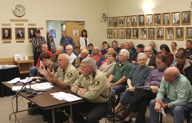 Klamath County Sheriff Frank Skrah, center at table, talks about the importance of public safety at a packed Klamath County Budget Committee meeting May 29 in Klamath Falls, Ore.