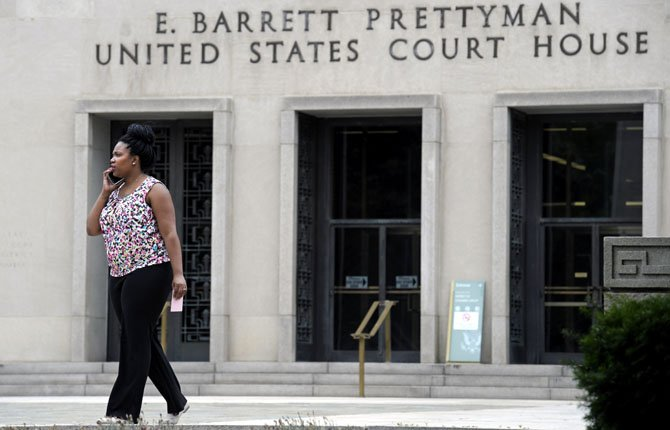 A woman talks on the phone outside the U.S. Courthouse in Washington, June 6 where the secret Foreign Intelligence Surveillance Court resides.