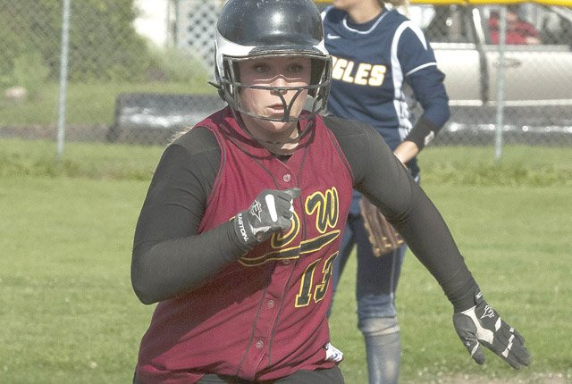 THE DALLES WAHTONKA athlete Katherine Kramer scurries to third base on a single during varsity softball action this past season. Kramer was recently voted on as a second-team all-state winner.