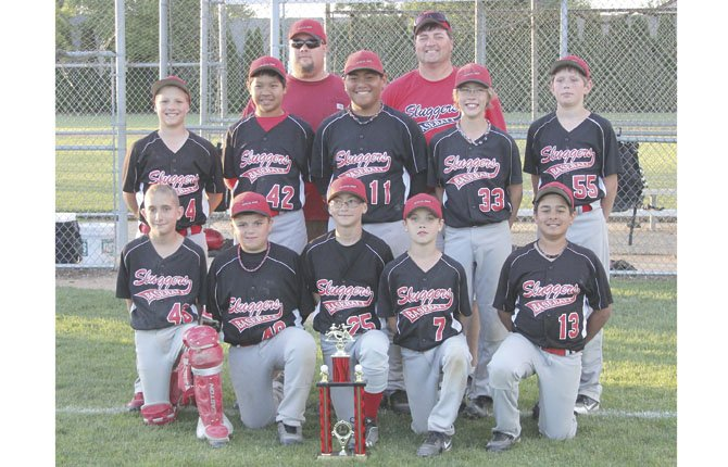 THE DALLES 12U Sluggers scored a third-place finish in a weekend Junior Baseball Organization Tournament in Sherwood. The players are (in front row, left to right), Austin Weir, Dante Avila, Baily Hakicek, Ben Schanno and Dominic Smith. In the middle row are (from left to right), Caden Mathisen, Harry Wilde, Dalles Seufalamua, Mac Abbas and Zackary Anderson. In the background are coaches Chris Schanno and Joe Abbas. Not pictured is assistant coach Mike Armstrong.
