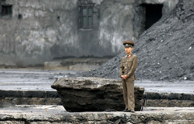 A NORTH Korean soldier stands on the river bank in Sinuiju, North Korea, opposite the Chinese border city of Dandong June 12. A much-anticipated meeting between North Korea and South Korea, which had been set for Wednesday, collapsed before it even began. But while the last-minute cancellation over a protocol dispute shows the Koreas' deep mutual mistrust, they may have more reasons than not to eventually unpack the meeting gear and get back to negotiations.