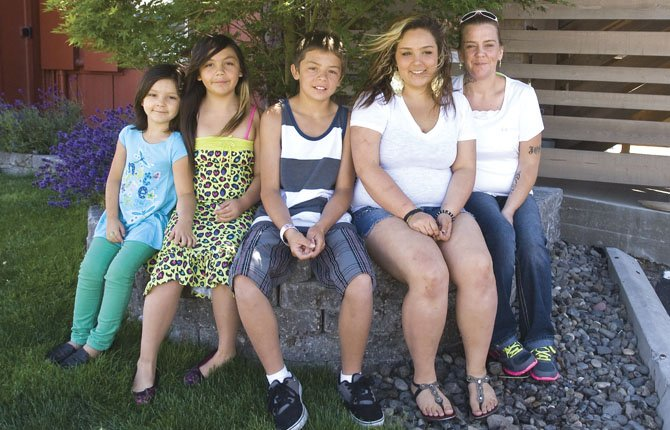 THE ALVAREZ family lost everything in a house fire early Sunday morning. Pictured are, left to right, Evea, 5, Emily, 8, Zach, 11, Blanca, 15 and mother Kate Alvarez.