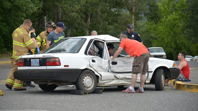 At the intersection of Cascade Avenue and 20th Street, three cars were involved in an accident June 11 when Samuel Nakamura, driver of a 1990 Toyota Corolla, attempted a left-hand turn from the eastbound lane of Cascade onto 20th Street, near the Subway deli. Emergency responders assisted two of Nakamura's passengers who were injured when another vehicle struck his vehicle's side as it traveled westbound on Cascade. A third vehicle, waiting at the adjacent stop sign, received minor damage.