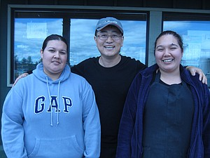 Mid Valley Market owner Yang Cho, center, enjoys happy relationships with his employees, including sisters Maribel and Nancy Ramirez.