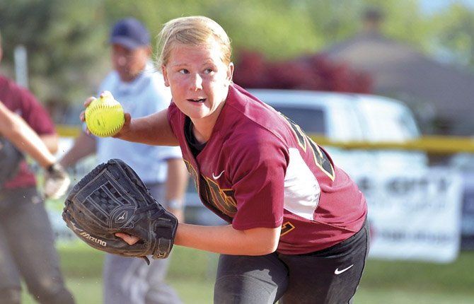 THE DALLES WAHTONKA graduate Kella DeHart makes a play in varsity softball action earlier this season in Hood River. DeHart received a scholarship to play softball at Blue Mountain Community College next spring.