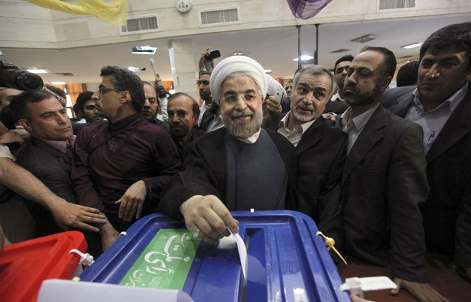 Iranian presidential candidate Hasan Rowhani, the country's former top nuclear negotiator, casts his ballot in the presidential election at a polling station in downtown Tehran, Iran, June 14.