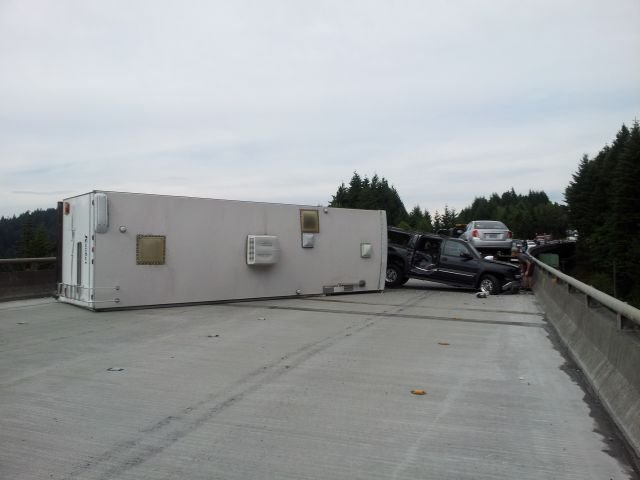 A TRAILER lies across both lanes of I-84 on Sunday. OSP was assisted at the scene by Hood River County Sheriff's Office and ODOT.