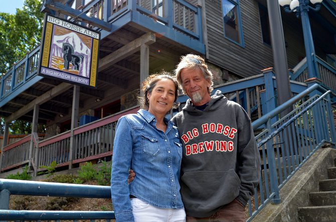 Randy and Susan Orzeck, Big Horse owners and founders, in front of their 25-year-old downtown business.