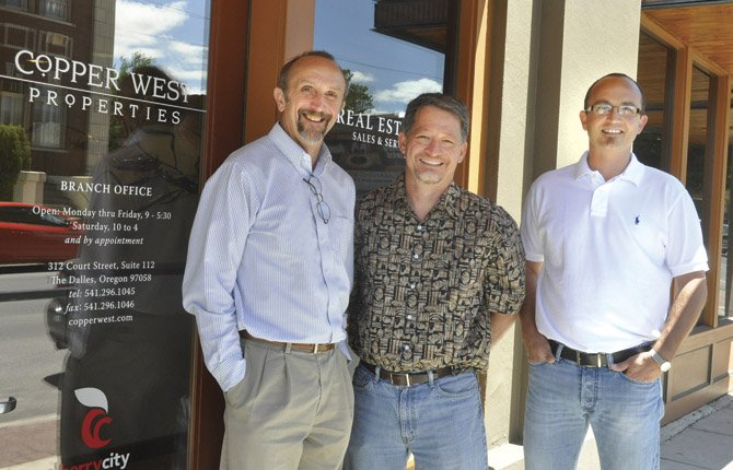 THE DALLES real estate brokers Dennis Morgan, left, and Keef Morgan, right, are among seven brokers opening a branch of Copper West Properties, a Hood River-based firm owned by Maui Meyer, center, and Ben Stenn, not pictured.