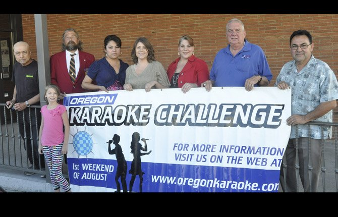 GORGE KARAOKE CHALLENGE PARTICIPANTS and supporters include, from left, Mel Mendez, Gameopoly; Alexandria McAllister, Moose team member; Gus Niskanen, Moose Lodge; Eddi Cruz, Allens' Market; Chelsea Albin, Optimist Printers; Dia Nickelsen, 2012 champion; Dick Coulson, Moose team member; Eloy Pando, event organizer.