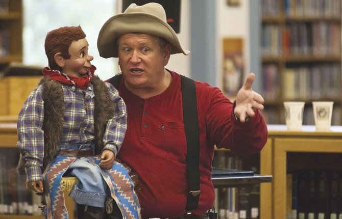 Steve Taylor and Rudy O'Riley tell stories and perform magic Tuesday, June 18, as The Dalles Wasco County Library kicks off this year's Summer Reading program, themed Dig Into Reading. Programs are scheduled Tuesday mornings from 11 a.m. to noon. through Aug. 20.