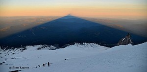 Like a great pyramid, Mount Hood casts a giant shadow all the way to central Oregon, seen at sunrise Sunday morning from The Devil's Kitchen.