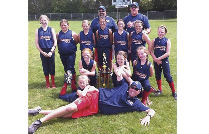 PLAYERS from the 10U Cherry City Crush softball team display a second-place trophy from play at the Father's Day Tournament in Newberg. The athletes are (pictured in the back row, left to right), Coach Leroy Tharp, Coach Darin Jacobsen, Coach Roger Hoylman. In the middle row (left to right), Mikayla Kelly, Savanah Ford, Alyse Wentz, Emma Bartlett, Grace Schatz, Kilee Hoylman and Rochelle Tilton. In the bottom row (left to right), Zoe LeBreton, Emma Smith, Kylan McCavic and Maddie Tharp. Not pictured is Ryan LeBreton. The Crush won their first game Saturday, June 15 against the Thurston Fillies 15-4, but then lost their second tourney game to Sweet Home Huskies by a 7-5 margin. On Sunday morning, they punched a finals ticket by winning their semifinals matchup against the Toledo HotShotz, 11-2 and lost the championship game to the tough McMinnville Grizzlies, 12-8. They play next at the three-day state tournament in Albany June 28-30.