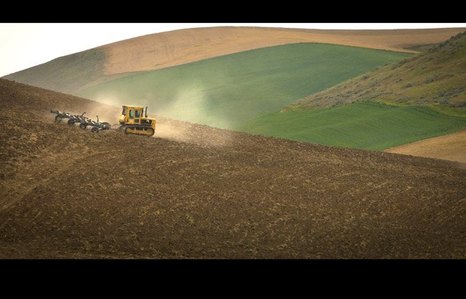A dry land wheat farmer prepares a field in this 2013 file photo. The House is expected to vote on a new farm bill Thursday.