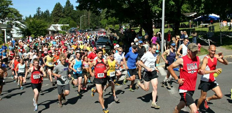 a hoard of runners takes off from the start of the June 15, sixth-annual White Salmon Backyard Half.