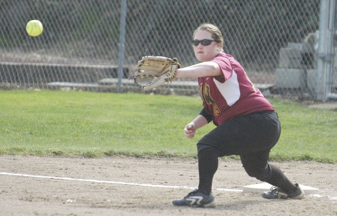 THE DALLES WAHTONKA graduate Melanie Taphouse makes a stretch at first base during softball action earlier this season. After a tryout in Pendleton, Taphouse was offered a scholarship to play at Blue Mountain Community College.