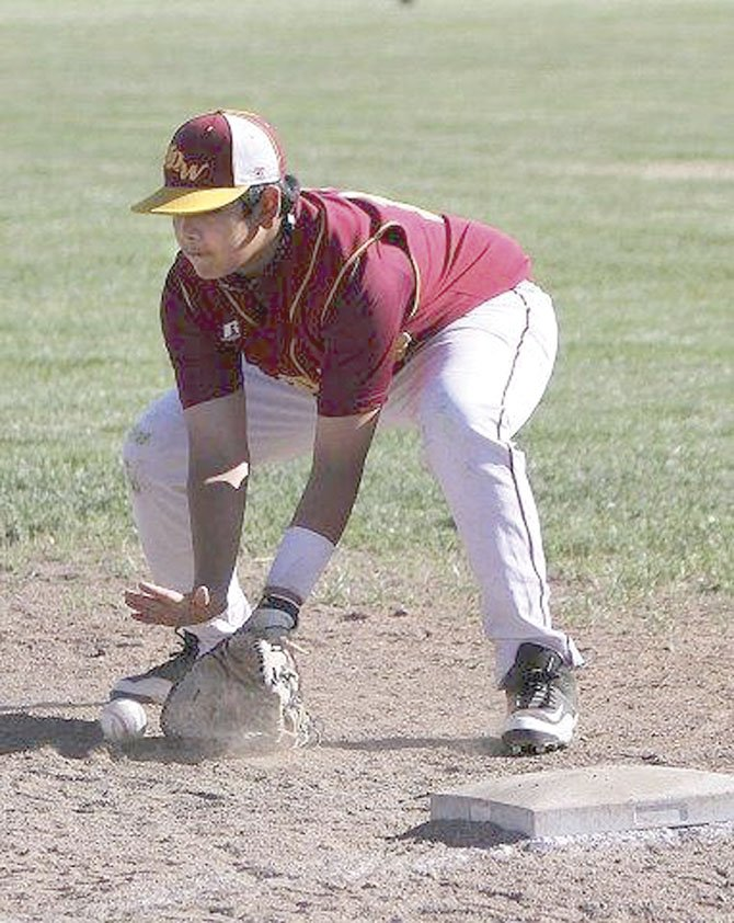 THE DALLES baseball player Boston Bate scoops up a ground ball during action at Wahtonka High School. Starting July 10, the 14U Babe Ruth squad is hosting a three-day, eight-team state tournament.