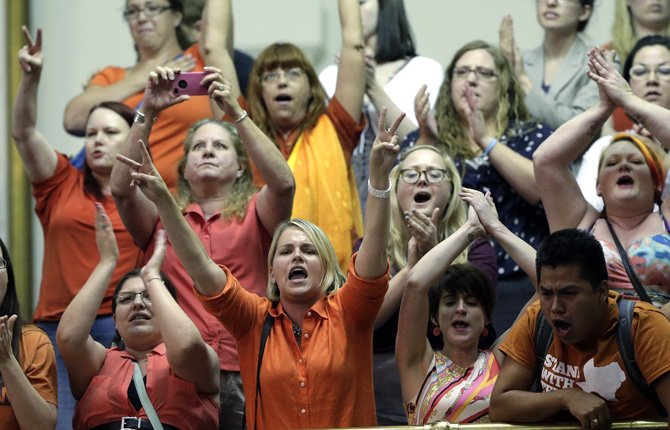 Members of the gallery cheer and chant as the Texas Senate tries to bring an abortion bill to a vote as time expires, June 26, in Austin, Texas.