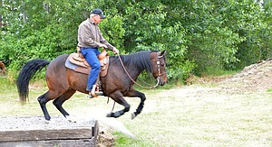 rider Kurt Osbourne  takes part in a Hood River Saddle Club event over the weekend in which they were challenged with different tasks on an obstacle course.