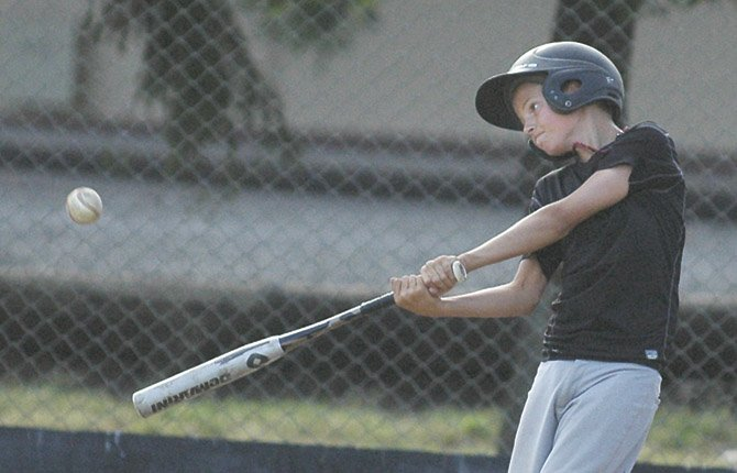 TD Little League player Tyler Vassar ropes a shot to the fence during batting practice Wednesday. TD heads to Bend for regionals starting Saturday.
