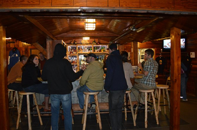 Guests enjoy a round or two at the recently expanded bar inside the Crooked Tree Tavern at Cooper Spur Mountain Resort on Tuesday. The tavern has six taps that primarily pour beer from local breweries.