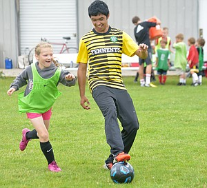 HRVHS playerEdgar Villegas  works with young soccer players during this week's Eagle Youth Soccer Camp, which brought 80 kids and several high school volunteers to Westside School for the week.
