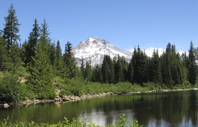 Heading to the forest, like Mirror Lake and Mt. Hood shown above, for hiking and camping means entering black bear terrority. Veteran outdoorsman Skip Tschanz offers tips on how to stay safe in bear country.