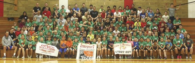 JUMPSTART Basketball camp participants take time out from fundamental practice to grab a group shot last week in the gymnasium at Dufur High School. A record crowd of 160 boys and girls from the second through ninth grades took part in the camp to sharpen up their game for the upcoming winter season.