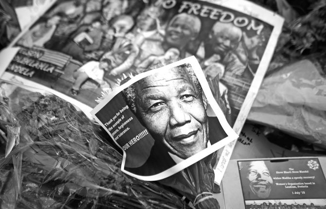 Photos, flowers and good wishes are laid in support of former South African President Nelson Mandela July 2 at the entrance of the Mediclinic Heart Hospital where Nelson Mandela is being treated in Pretoria, South Africa. Mandela remained in a critical condition on Tuesday.