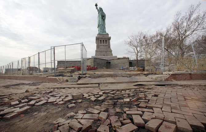 In a Nov. 30, 2012 file photo, parts of the brick walkway of Liberty Island that were damaged in Superstorm Sandy are shown during a tour of New York's Liberty Island.