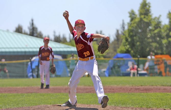 THE DALLES Little League all-star pitcher Zach Anderson winds up for a pitch during 11U action Sunday afternoon at Lava Ridge School North in Bend. The squad is now 2-0 and in the quarterfinals.
