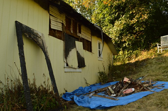 The exterior of this house at 1335 Cascade Ave., as well as its interior, was charred after a fire started in one of its bedrooms Friday evening. Both of its residents, Jessica Sanderson and Steve Millea, were not home at the time of the fire, which is believed to be electrical in orgin.
