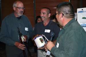Corey Yasui, right, and Wes Bailey, center, share a laugh with grower Robin Locke, who won a new pair of loppers in a drawing of sponsor-donated gifts. Yasui compiled a hardcover book of historic Diamond photos that was given out to members at the event.