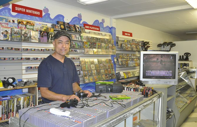 MEL MENDEZ has video games for a variety of consoles, both old and new, but new practices in the gaming industry are taking a bite out of his business.