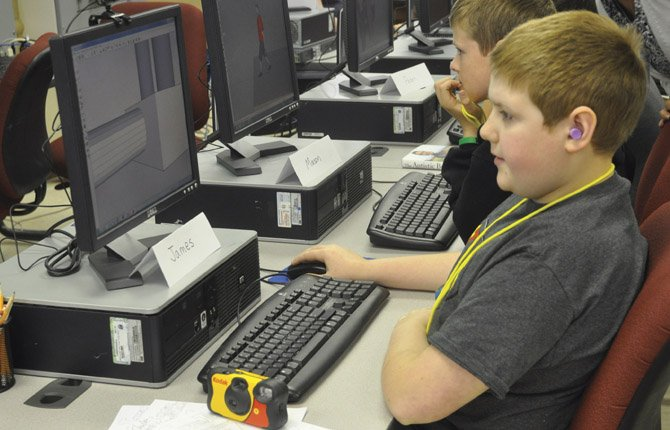 James McIntosh, foreground, and Mason Miller use the computer program SketchUp to create three-dimensional designs during a weeklong program called iSTAR, which teaches computer aided design skills to students on the autism spectrum.