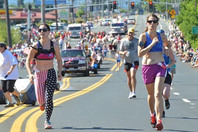 The 2013 Kollas-Cranmer Memorial Run on July 4 drew a record number of participants and produced some hot times that matched the weather of the day. Runners head down 12th Street before the parade starts.