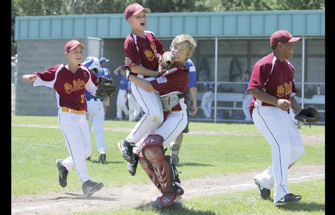 THE DALLES Little League All Stars (pictured from left to right), Mike Armstrong, Ben Schanno (in air) and catcher Mac Abbas celebrate a big 4-2 win Friday in district playoff action in Bend. The win vaulted TD into the 11U title game.