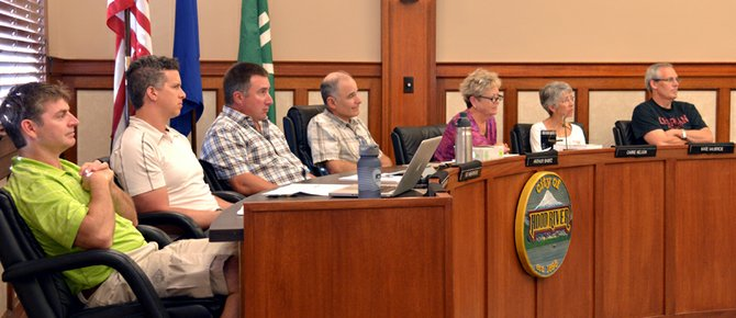 Hood River City Council members(from left) Brian McNamara, Laurent Picard, Ed Weathers, Mayor Arthur Babitz, Carrie Nelson, Kate McBride and Mark Zanmiller listen to testimony in favor of City Manager Bob Francis.