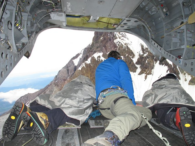 Searching out the back of a Chinook helicopter for the missing climber.