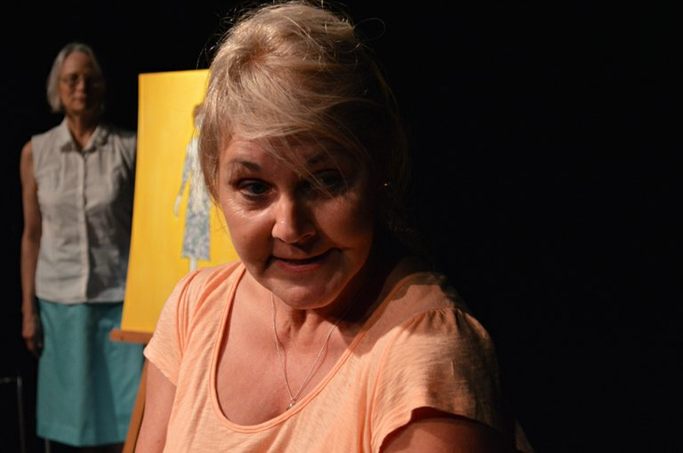 Ginger (Brenda Hering) remembers what a certain dress meant to her, and the people from her life at that time. In the background is Irene Fields. Clothing art is done by Cathleen Rehfield, J. Niels Harvey and Karen Watson.