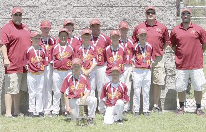 THE DALLES 11U All Stars proudly display their second place trophy after going 3-2 in a weeklong stay in Bend for the District 5 Little League Baseball Tournament. The Players and coaches are (in front row, from left), Ben Schanno and Steven Preston. In the middle row are Gabe Helseth, Dominic Smith, Josh Johnson, Mike Armstrong and Austin Weir. Standing in the back row are assistant coach Chris Schanno, Zach Anderson, Sam Thalhofer, Dalles Seufalemua, Mac Abbas, Manager Joe Abbas and Assistant Coach Mike Armstrong.