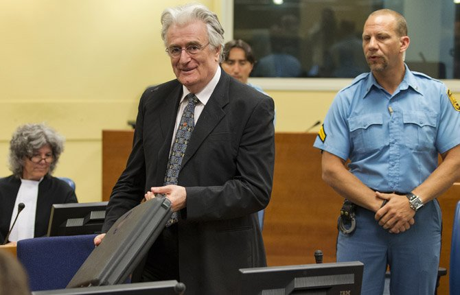 FORMER BOSNIAN Serb leader Radovan Karadzic enters the courtroom of the U.N. Yugoslav war crimes tribunal (ICTY) in The Hague, Netherlands, July 11. Judges at the ICTY are ruling on a prosecution appeal against Karadzic's acquittal on genocide charge, one of the key allegations against him over atrocities during Bosnia's bloody war.