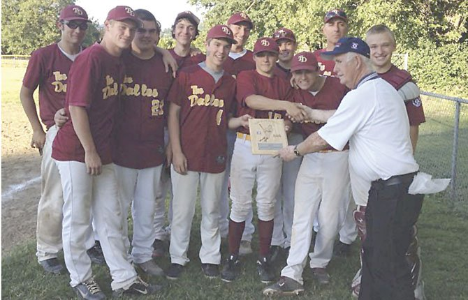 THE DALLES 15U Babe Ruth All Stars are congratulated by Butch Hert after scoring a decisive win over Clackamas on Sunday. The victory secured a district crown and a No.1 seed at the state tournament in Baker City.