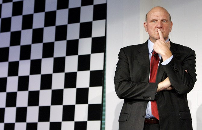 In this Wednesday Oct. 7, 2009, photo, Steve Ballmer, CEO of US computer software company Microsoft, follows a news conference in Munich, southern Germany.  Microsoft Corp. announced Thursday, July 11, 2013 it is reshuffling its business in an attempt to promote faster innovation and a sharper focus on devices and services.