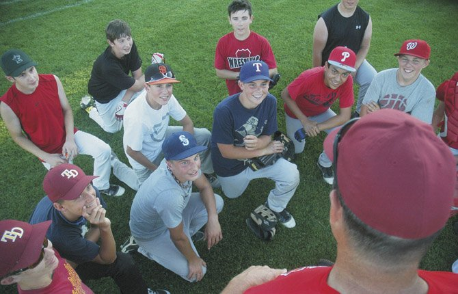 THE DALLES 13U Babe Ruth All Stars share a laugh with head coach Jeff Justesen after a two-hour practice Tuesday at Kramer Field in The Dalles. Starting at 11 a.m. and 5 p.m. Tuesday, this group is in baseball action for the North Oregon State Tournament in Baker City.