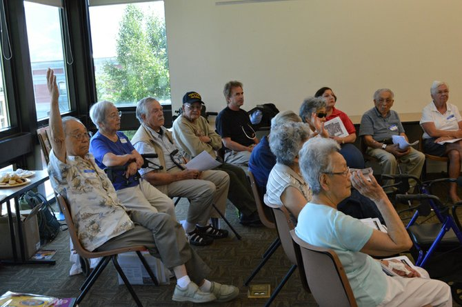 National Park Service employees listen to feedback from guests at a July 2 meeting in Hood River about how to best restore the Tule Lake Segregation Center. Many who attended the meeting were Hood River Nisei who were incarcerated in the notorious WWII internment camp.